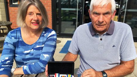Suzie Morley and John Harvey with William Harvey's medals. Picture: PAUL GEATER