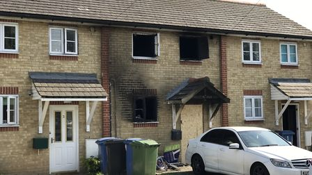 The four-story home was blackened by the blaze Picture: NEIL DIDSBURY
