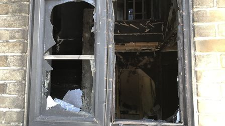 Windows were blackened and broken by the heat Picture: NEIL DIDSBURY