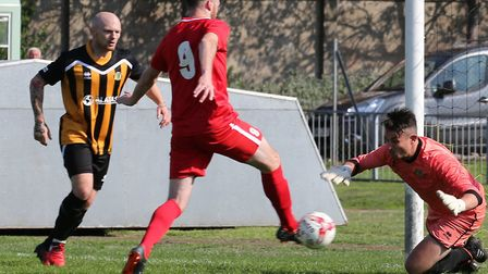 Stowmarket's Ollie Canfer pokes home for the visitors at Yarmouth on Saturday Photo: STEVE WOOD