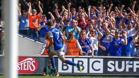 Town fans celebrate as Gwion Edwards wheels away after giving Ipswich a 1-0 lead against Norwich. Ph