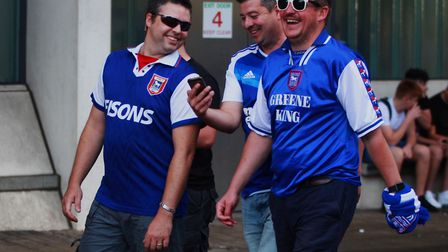Ipswich Town fans make their way into the ground for the East Anglian Derby v Norwich City at Portma