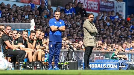 Town manager Paul Hurst and Norwich City manager Daniel Farke watch from the touchline. Picture: