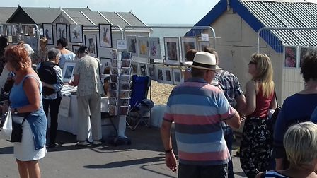 Art enthusiasts enjoying the open air exhibition Picture: LAURA BEARDSELL-MOORE