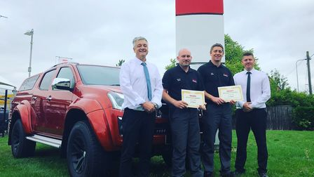 Hammond Isuzu technicians Lee Cayley, second right, and Aaron Fenn, second left, with service manage
