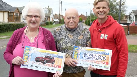Patricia and John Welham celebrate their People's Postcode Lottery win with Jeff Brazier Picture: PH