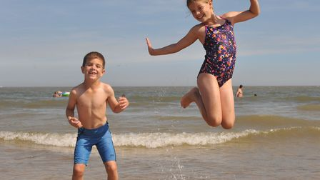 Luca and Ellie Smith loving the hot weather Picture: SARAH LUCY BROWN