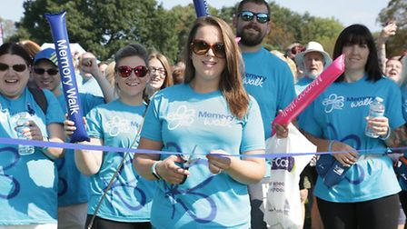 Sophie cutting the ribbon at the first ever Ipswich Memory Walk Picture: PAT STOCKLEY