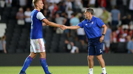 Luke Woolfenden shakes hands with Ipswich Town manager Paul Hurst in pre-season. The teenage defende