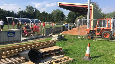 A typical non-league scene: a stand, a dugout, a tractor, a cone, Columnist Carl Marston captures th