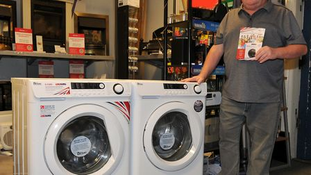 Halstead electrical retailer David Day, with some of the British made Ebac washing machinesn he is s