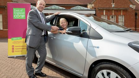 Linda Houseley, from Felixstowe, is handed the keys to her new car by East of England Co-op chief ex