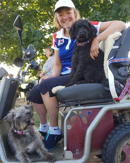 The scooter Julie uses to lead the dogs is a regular mobility buggy - with the acceleration tweaked