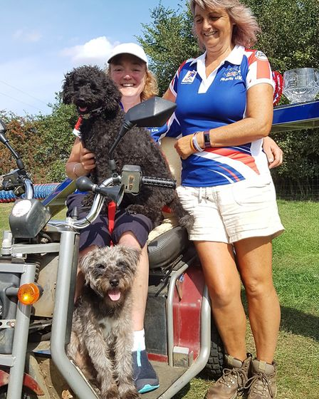 Julie Thomson with trainer Jacqui Wood alongside ParAgility world champion Dodger (footwell) and run