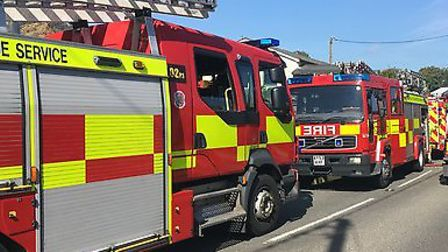 Firefighters on the scene of a fire in Parham Picture: ANDREW HIRST