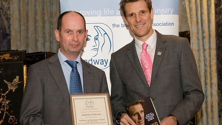 Andrew Pearson receiving a national Headway UK 'Achiever of the Year' award in December 2012 from do