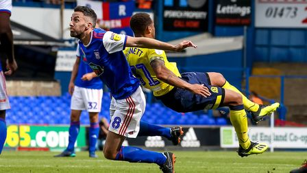 Cole Skuse and Elliott Bennett collide in Town's opening day draw with Blackburn. Photo: Steve Walle