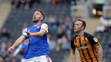 Cole Skuse under pressure from Hull's Todd Kane. Photo: Pagepix