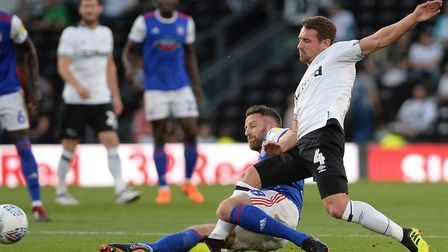 Cole Skuse slides into a challenge at Derby. Photo: Pagepix