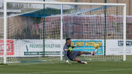 Tamworth stopper Jas Singh is beaten by Christy Finch's penalty kick for Leiston's second goal. Pict
