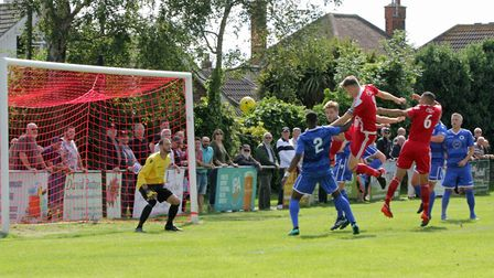 Felixstowe's Josh Kerridge (number 8) heads over the Walthamstow bar in their FA Cup clash. Picture: