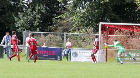 James Peagram (out of shot) scores what proved to be the winning game for Walthamstow. Picture: PHIL