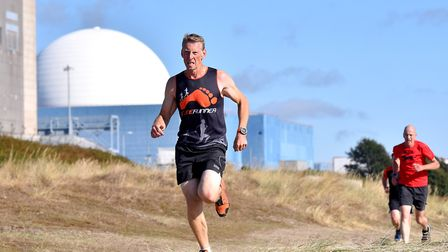 Runners taking part in the first ever parkrun at Sizewell beach.Picture: Nick Butcher