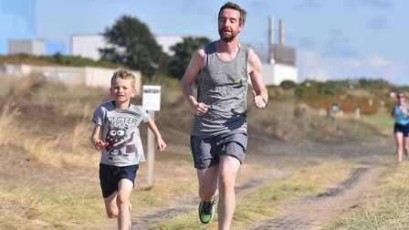 All ages took part in the inaugural Sizewell parkrun, with the nuclear power station in the backgrou