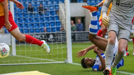 U's substitute Mikael Mandron takes a tumble in the penalty area late on. Picture: STEVE WALLER
