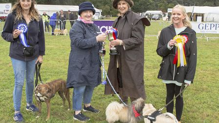 Winner of best in show Wookie and is owner received first prize from Jenny Tolhurst Picture: MARK JA