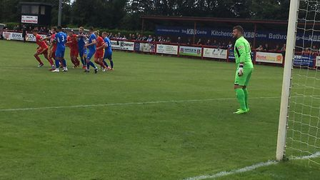 Leiston keeper Marcus Garnham is on the alert from an early Needham Market attack. Picture: CARL MAR