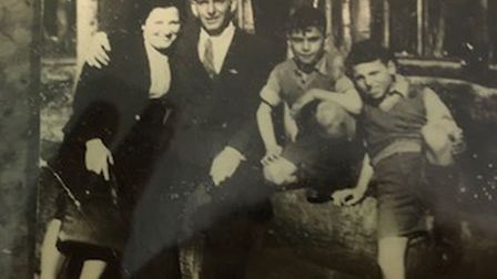 Bob with his parents and brother Jeff Picture: SHELLEY FAMILY