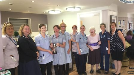 Davers Court care home in Bury St Edmunds presenting its local district nursing team, who support th