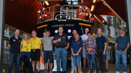 Belinda and James Richardson, pictured in yellow, stop off at the Aldeburgh RNLI lifeboat station on
