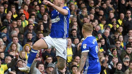 So close to victory. Town's Luke Chambers celebrates his late goal at Carrow Road last season to giv