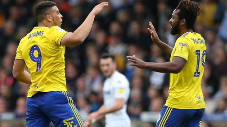 Che Adams (left) celebrates scoring his side's second goal of the game at Elland Road with team-mate