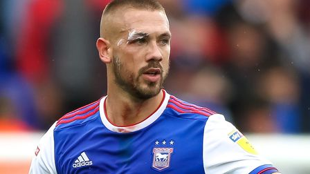A blooded Luke Chambers heads off the pitch to change his shirt after suffering a cut above his eye.