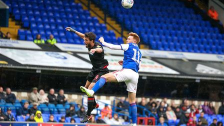 Jon Nolan wins the ball in this aerial challenge with Jason Lowe. Picture: STEVE WALLER WWW.S