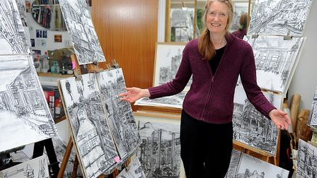 Artist Valerie Irwin with some of her artwork showing the redevelopment work on Ipswich Waterfront.