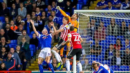 Dean Gerken punches clear as Brentford put the pressure on in the second half. Picture: STEVE WAL