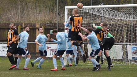 Phil Weavers goes close with a header in Stowmarket Town's 1-0 defeat at Godmanchester. Weavers retu