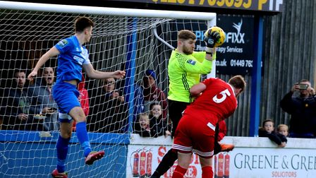 Kyran Clements, left, in action for Bury Town against Bowers & Pitsea. Defender Clements scored in t