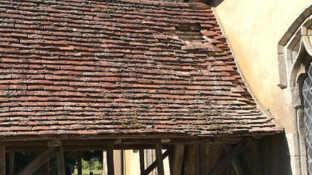 Damage to the roof caused by the lead thieves Picture: RHETT CORCORAN