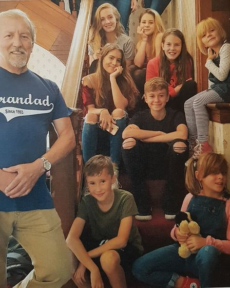 Clive pictured with eight of his nine grandchildren on a family holiday. Picture: RACHEL EDGE
