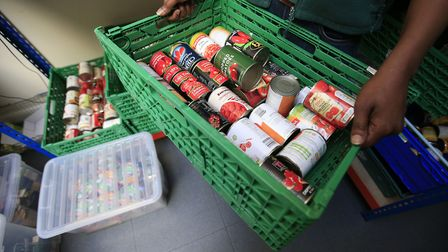Food being sorted at a foodbank. Plans to move more people on to Universal Credit could spark a huge