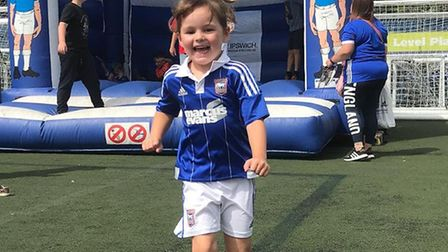 Young Penny Waters, who lost her eye to cancer, in her Ipswich Town kit Picture: VICTORIA WATERS