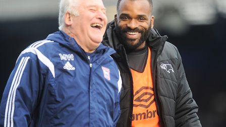 Darren Bent shares a joke with recently retired Ipswich Town goalkeeper coach Malcolm Webster upon h