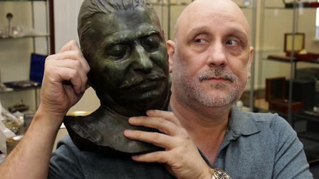 Lockdales managing director Daniel Daley with the brass death mask of Joseph Stalin �which sold for