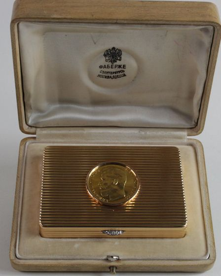 A secod Russian piece was sold at auction on Thursday. This solid gold Faberge box with medal went f