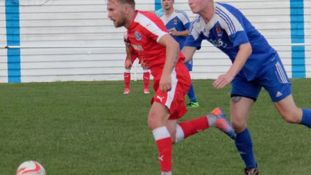 Rob Eagle, in red, has joined Lowestoft from Leiston. Picture: PAUL VOLLER